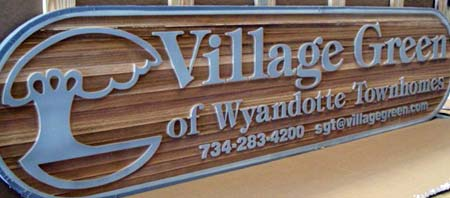 wooden sandblasted sign after blasting with blast mask still applied